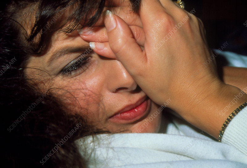 Depressed woman with hands held to her face