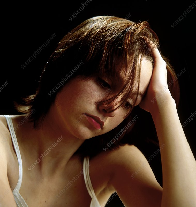 Head and shoulders of depressed woman