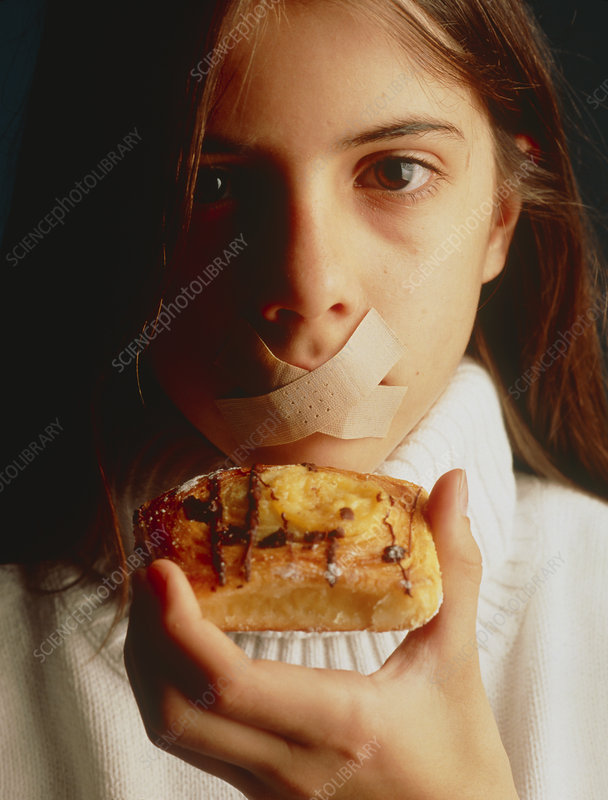 Eating disorder: girl with tape over her mouth