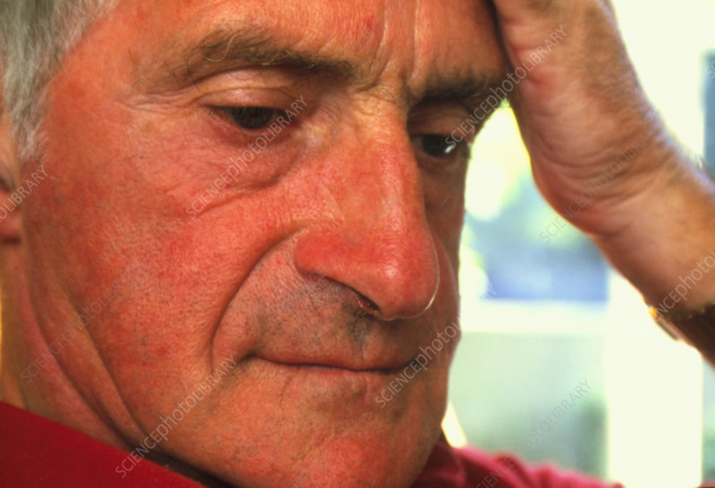 Close-up of a depressed elderly man