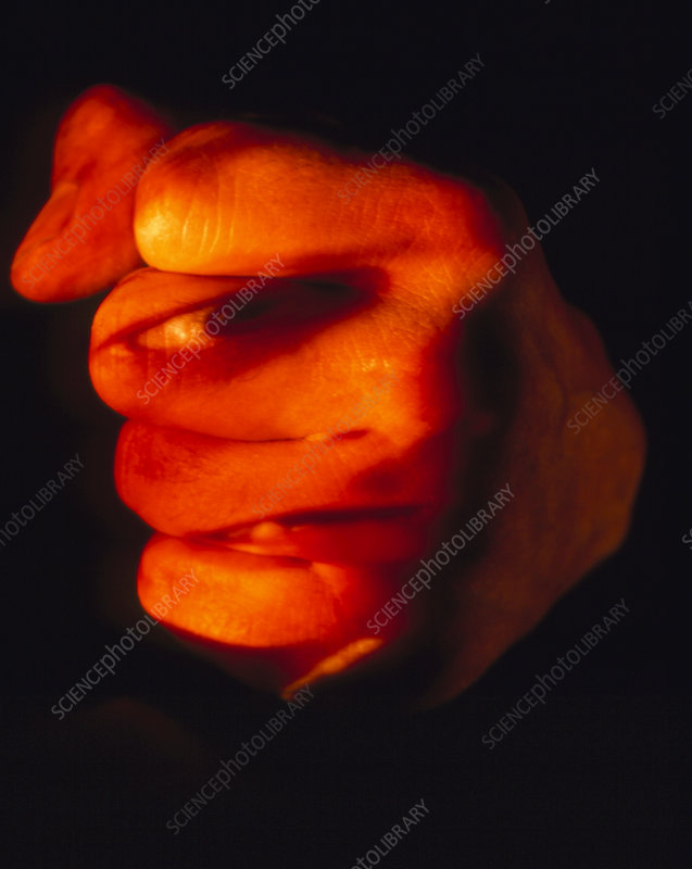 Abstract image of a face on a man's clenched fist