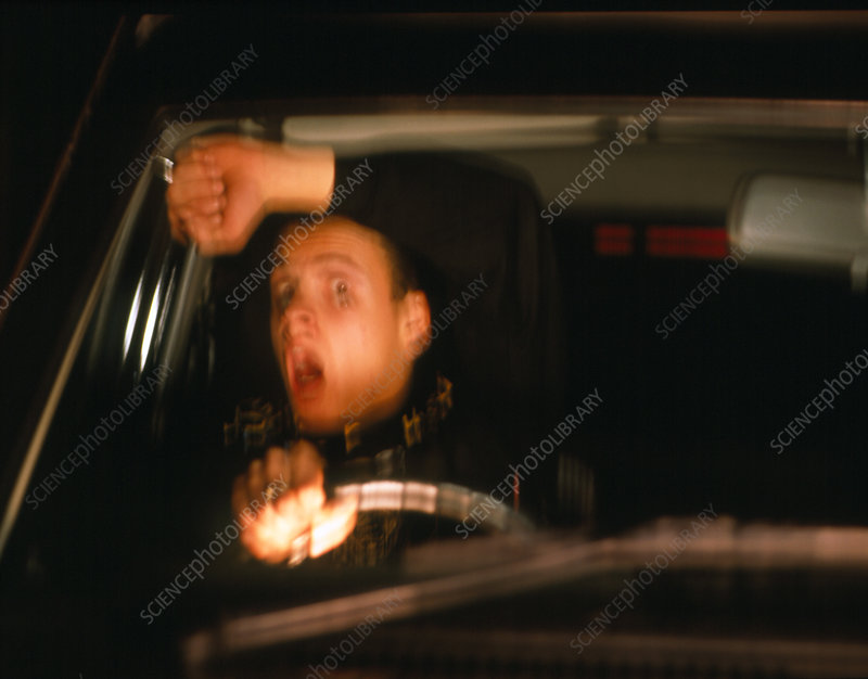 Terrified man driving a car about to crash