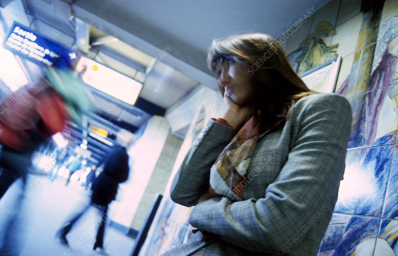 Stressed businesswoman on an underground station