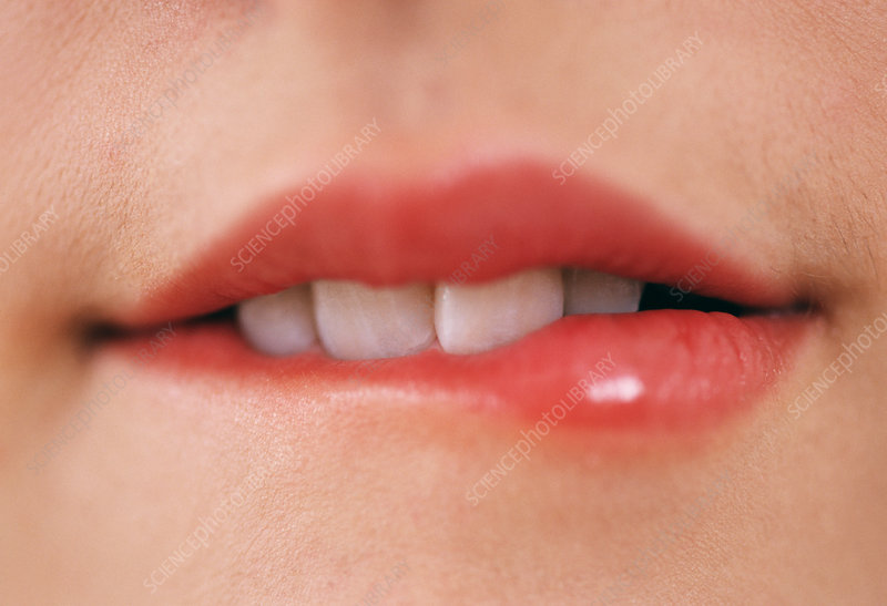 Woman biting her lip - Stock Image - M245/0761 - Science