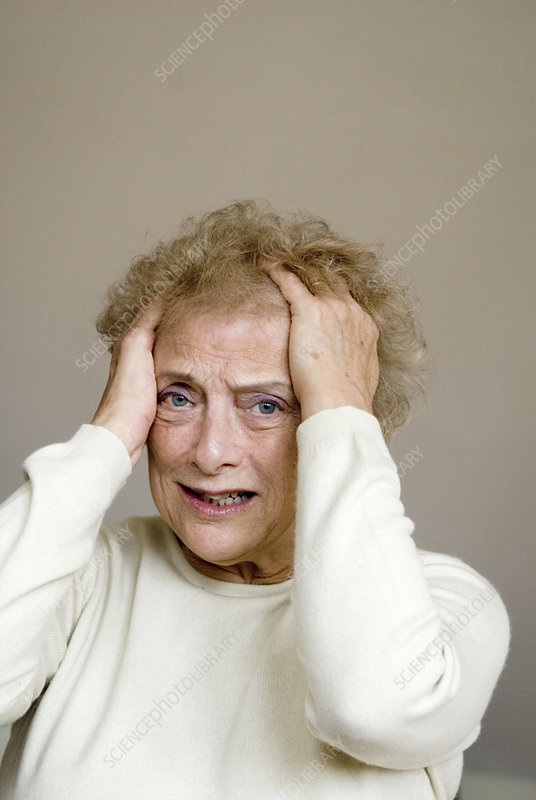 Upset elderly woman