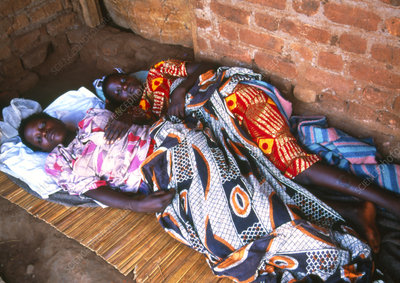 Teenage girls with sleeping sickness await doctor