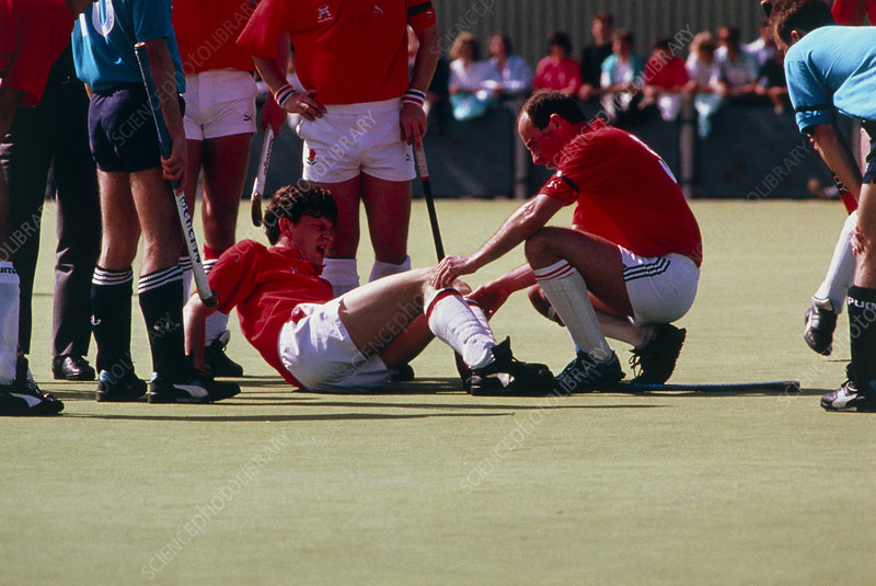 Hockey player injured on the field.
