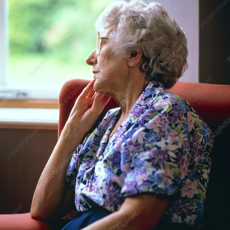 Loneliness: elderly woman stares out of window