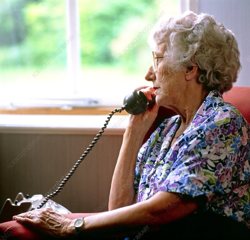 Loneliness: elderly woman makes a telephone call