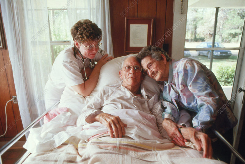 Old-age care: nurse with elderly couple in home