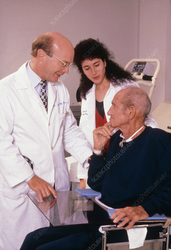 Doctor & nurse assessing stroke patient