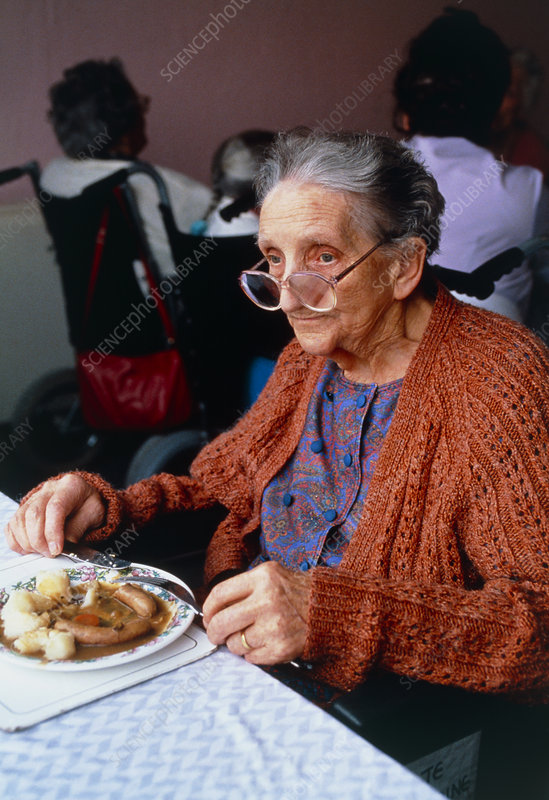 View of an elderly woman eating her dinner