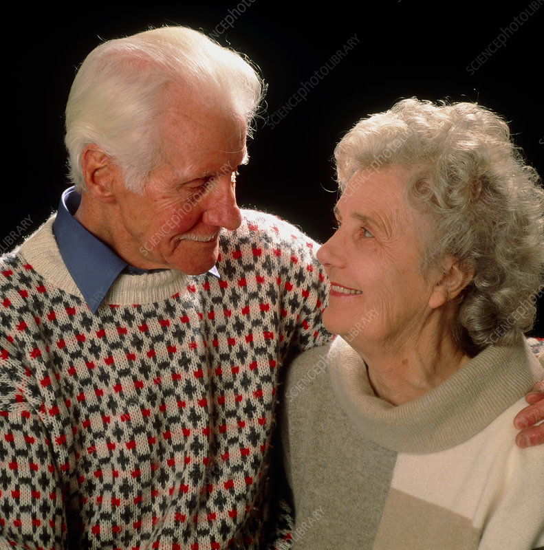 Elderly couple in each other's arms