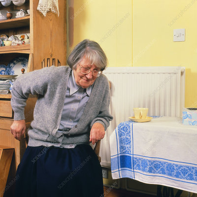 Elderly woman has difficulty rising from chair