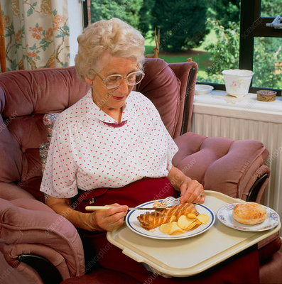 Elderly woman with unhealthy meal