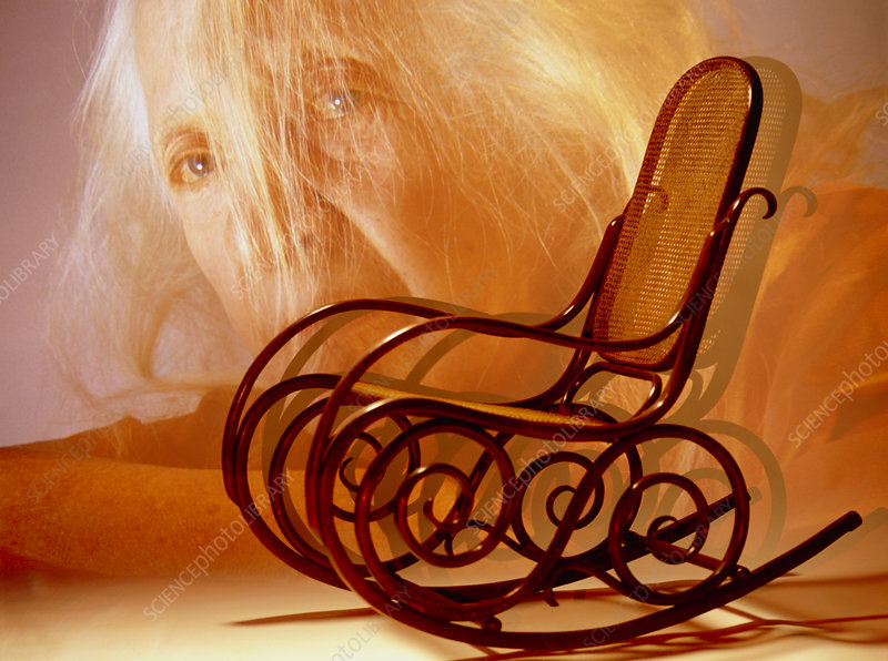Aging: elderly woman's face and a rocking chair