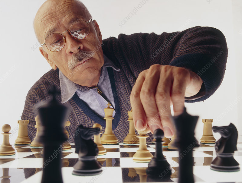 Elderly man plays a game of chess