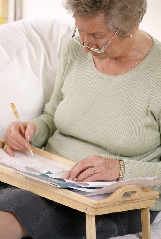 Elderly woman writing