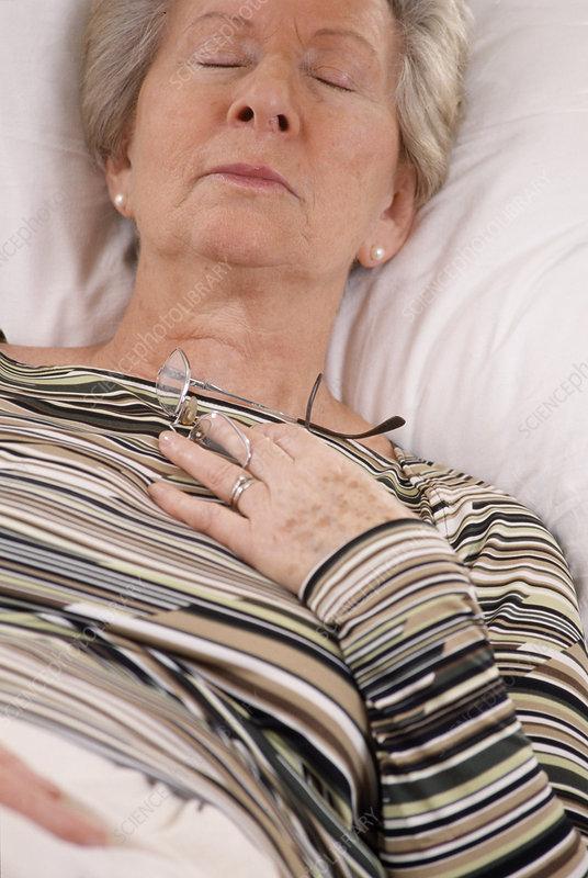 Elderly woman resting