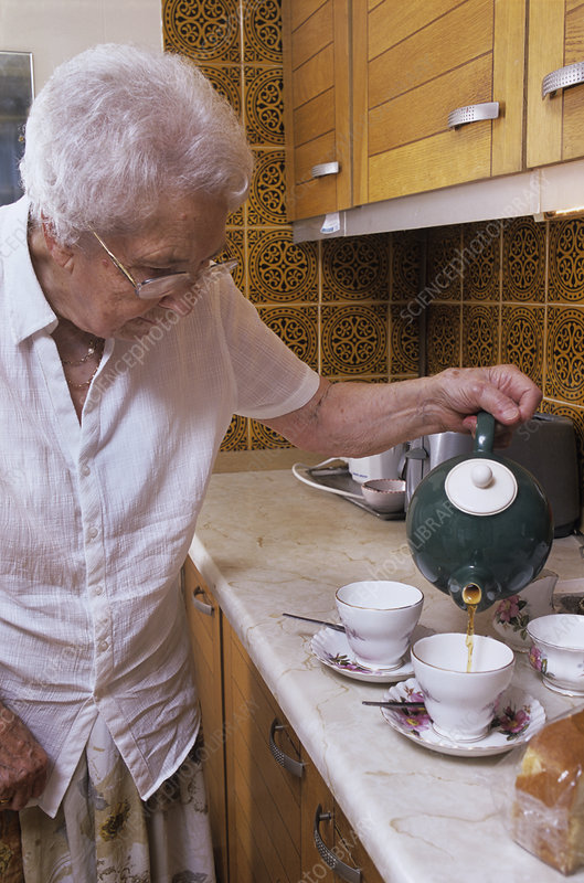 Elderly woman making tea