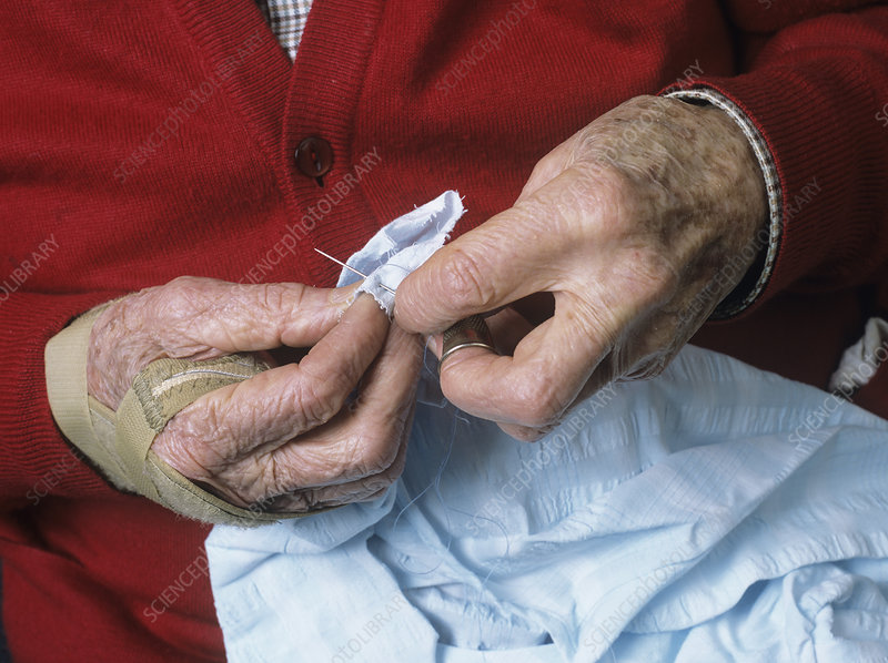 Elderly person sewing