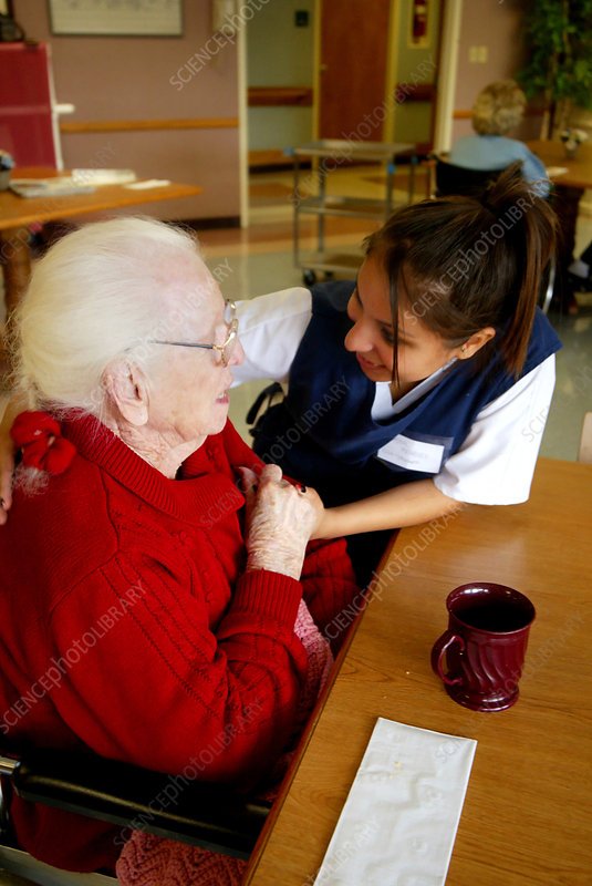 Nurse Interacting With an Elderly Woman