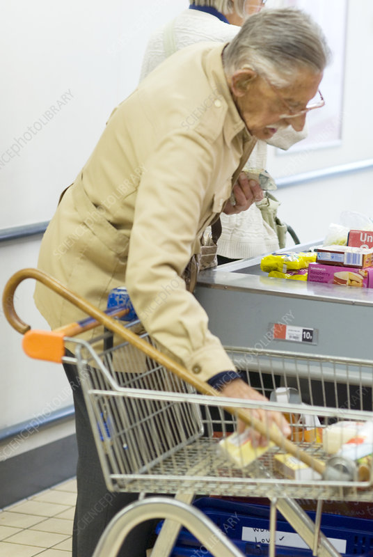 Elderly man at a check-out