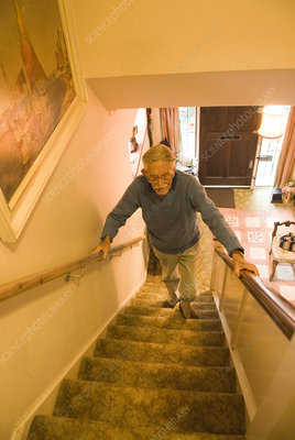 Elderly man climbing stairs