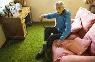 Elderly man sitting on a sofa
