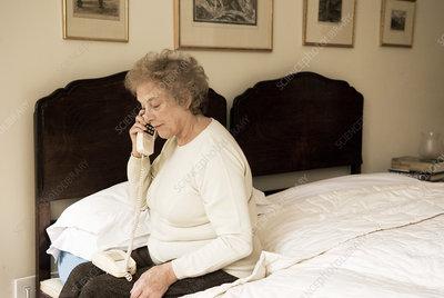 Elderly woman using a telephone