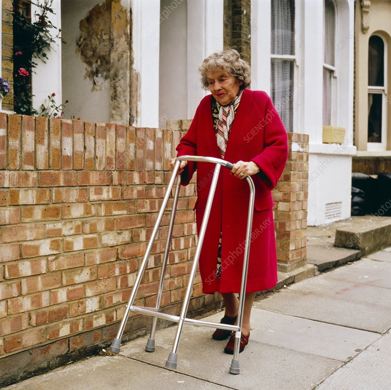 Elderly woman with walking frame