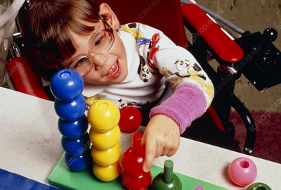 Child with cerebral palsy playing at school