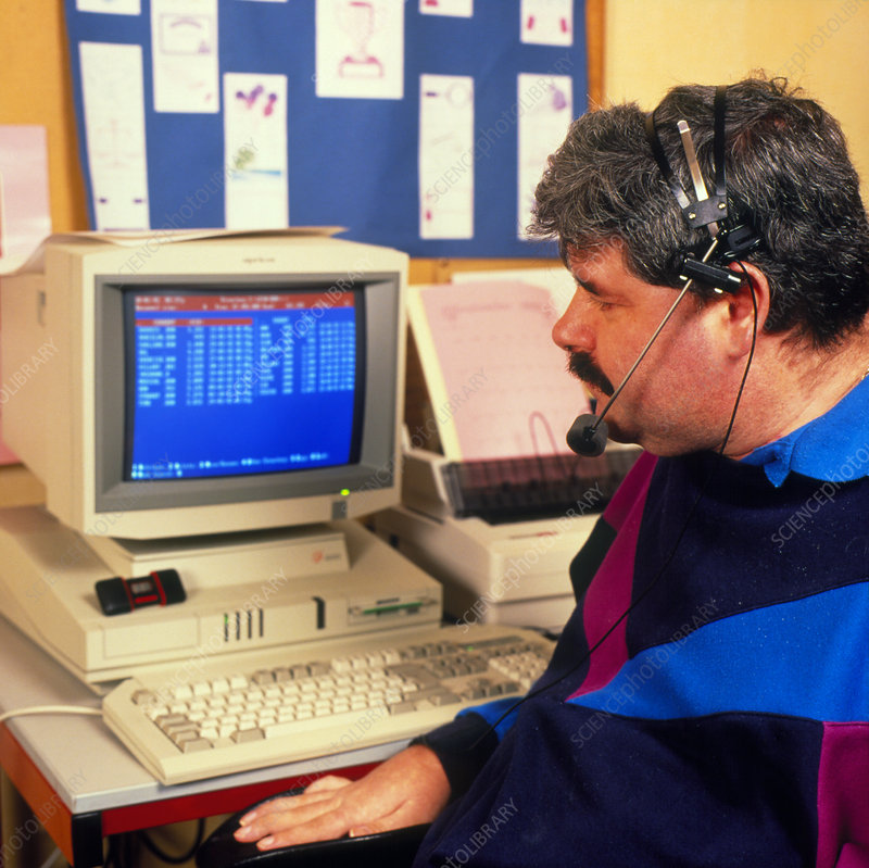 Handicapped man using specially designed computer
