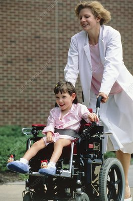 Child with cerebral palsy being wheeled about