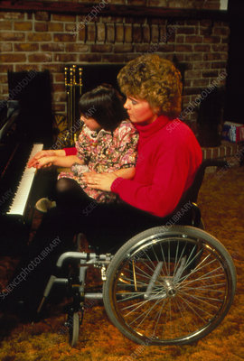 Handicapped mother teaching her daughter piano