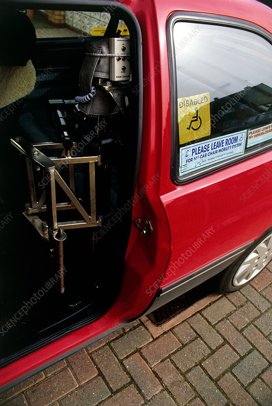 showing a wheelchair lift which hoists the disabled driver into and out