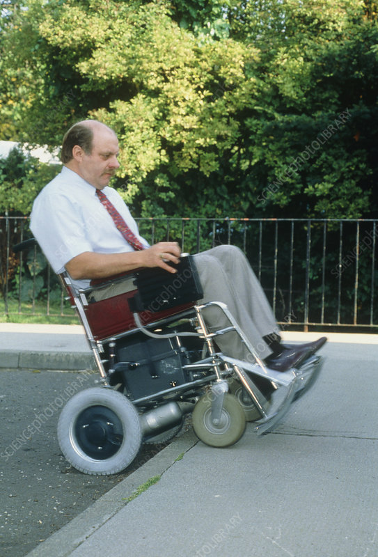 View of a man in a pavement-mounting wheelchair