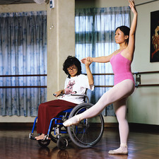 Wheelchair user teaching ballet