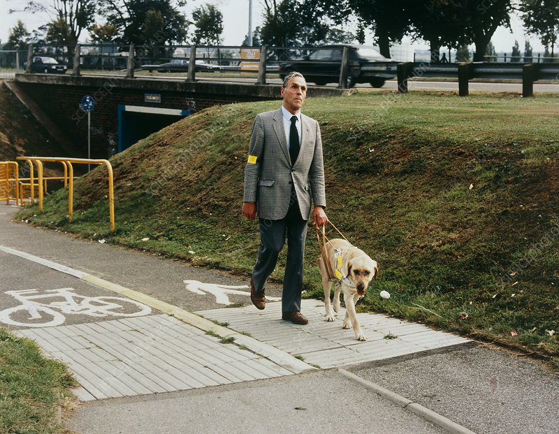 Blind man on tactile footpath