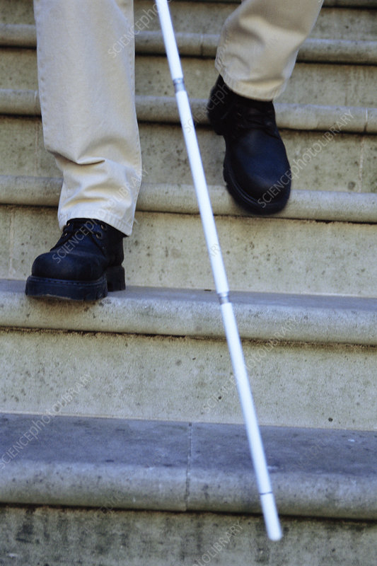 Blind man descending stairs