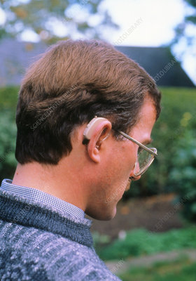 Man wearing a hearing aid.