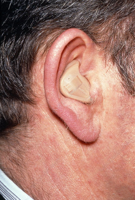 Multi-channel automatic hearing aid in man's ear