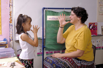 Deaf student learning sign language
