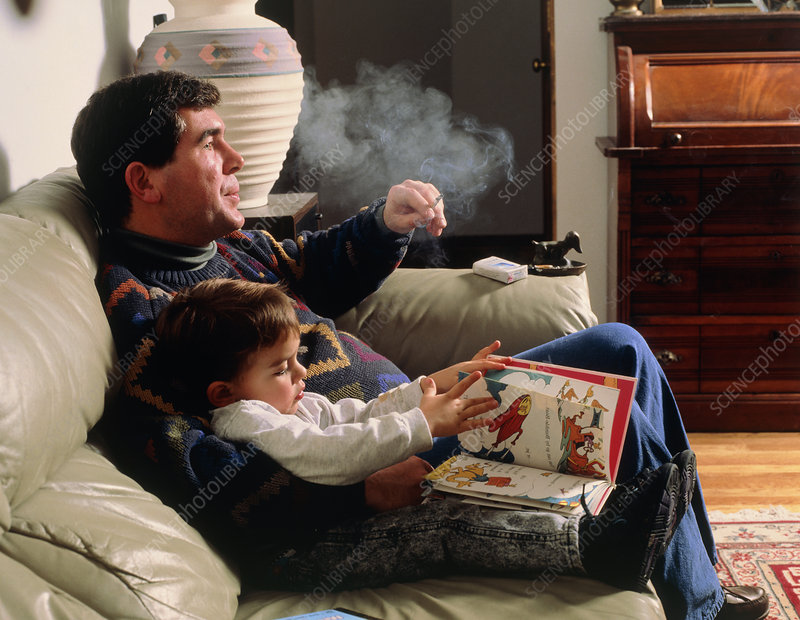 Passive smoking: father smokes in presence of boy