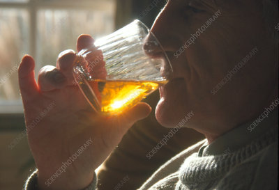 Profile of a man drinking alcohol