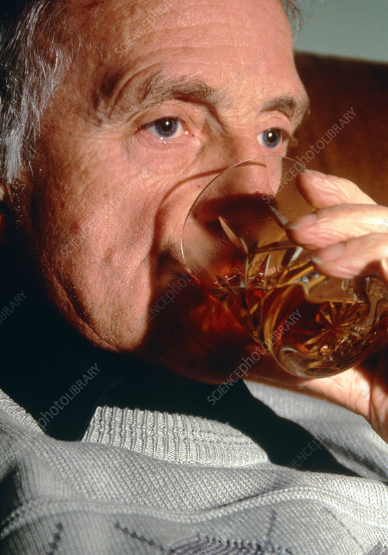 Elderly man drinking alcohol