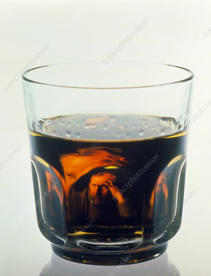 Glass of alcohol with alcoholic man