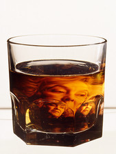 Glass of alcohol with image of alcoholic woman