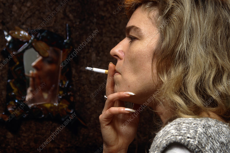 Side view of a woman smoking a cigarette