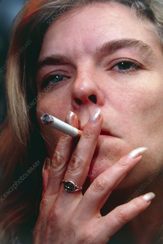 Face of a woman smoking a cigarette